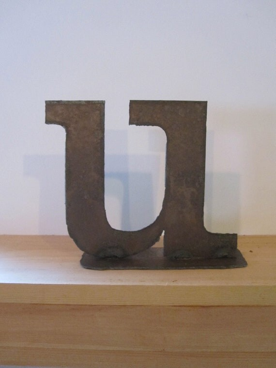 """Ready to Ship. Lowercase metal letter """"u"""" on stand"""