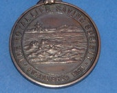 The Royal Life Saving Society Bronze Medal Awarded to RA Young in 1905