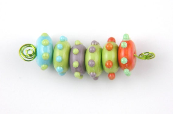 Handmade Lampwork Glass Bead set. Donuts with raised dots.