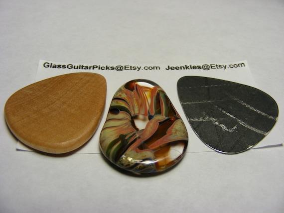 Guitar pick Box set of 3 different picks, set includes a Glass guitar pick, Wood guitar pick, and Stainless steal guitar pick,