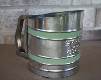 Vintage silver and green flour sifter