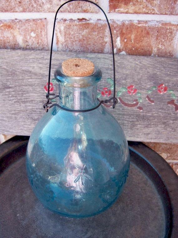 Antique bee trap, aqua glass