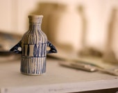 Illustrated blue Porcelain Bottle with arms