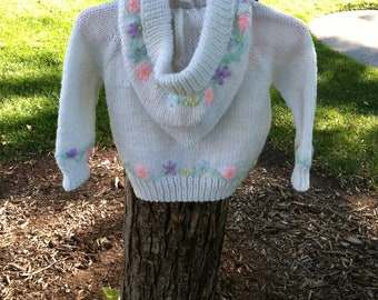Hand knit child's hooded flower sweater