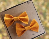 Set of two small wool felt bows in Butternut Squash Yellow - lbratt
