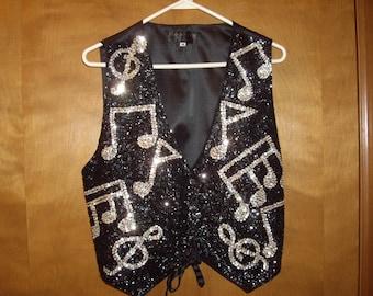 Musical beaded vest.