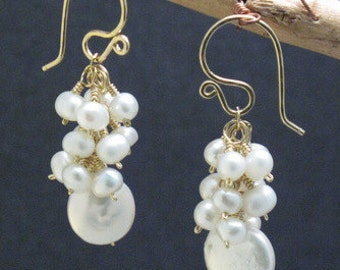 Clusters of ivory pearl earrings Cosmopolitan 32