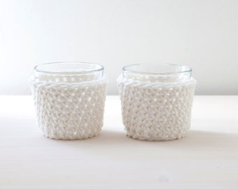 Set of two tea light holders with a white crocheted cover