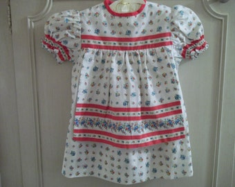 Vintage baby clothes 1940s Hand made cotton 1940s  flowered dress with attached  apron white red blue and green cottage baby dress  colors
