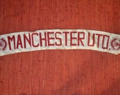 vintage Manchester United Football Club banner or sash