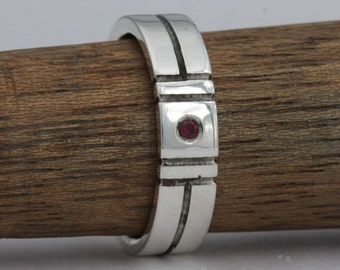 Size 10 sterling silver and garnet band, #252.