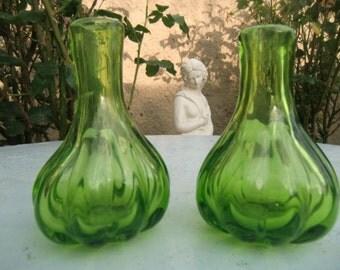 Two small bottles bottle green