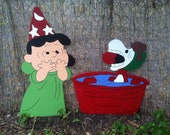 Lucy and Snoopy bobbing for apples
