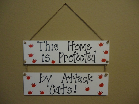 this home protected by attack cats .. waterproof hanging sign