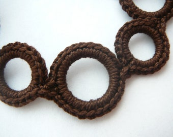 Brown pacifier clip. Baby paci keeper. roundrings- so unique. (universal style- fits mam, soothie, nuk)   Made by lippybrand