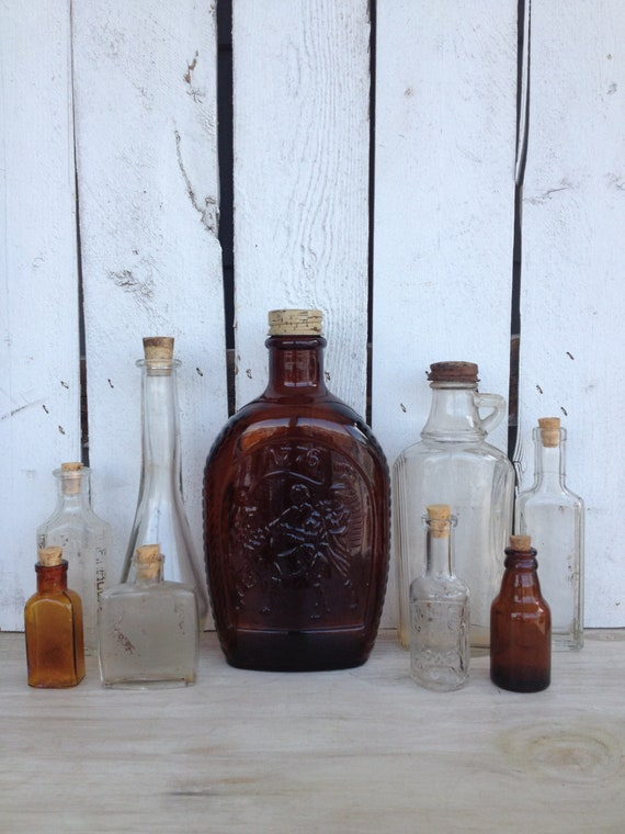 vintage amber and clear glass bottles with tops by MellaFina