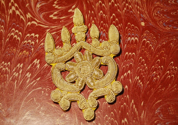 Gold colored thread symbolic patch, maybe military, found object, old, never used