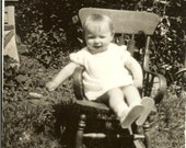 Antique Photograph of a Baby In a Rocker
