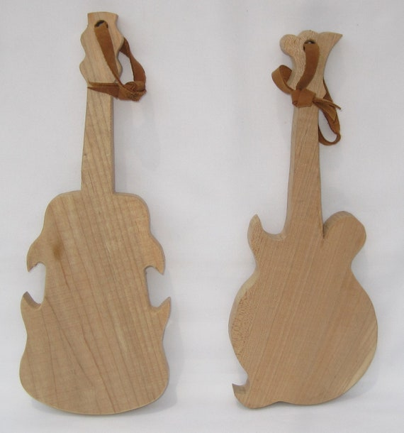Cutting boards shaped like musical instruments.
