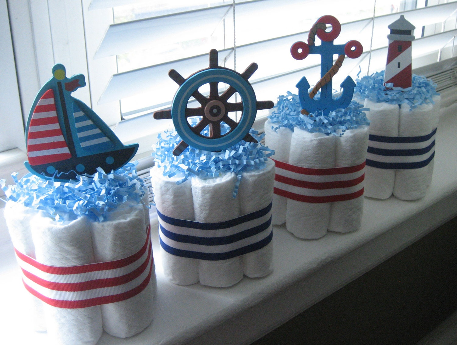 Four nautical mini diaper cakes for baby by for Baby shower diaper decoration
