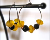 honey gold. yellow. sea glass. black glass beads. antiqued copper hoop earrings.