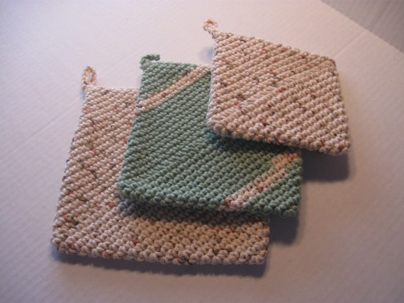 Set of 3 crocheted potholders of double thickness in greens and tans