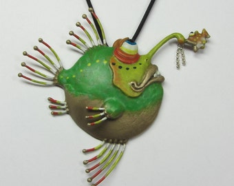 "Whimsical Bronze Hand Colored Angler Fish Necklace, ""Gettin' A Nibble II"" On Rubber Cord."