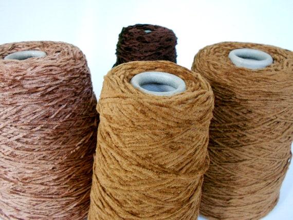 Brown chenille yarn cones in ocher, mink, tobacco, and dark truffles
