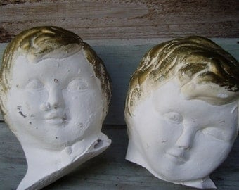 architectural salvage, greek sculpture heads, cupid is dead