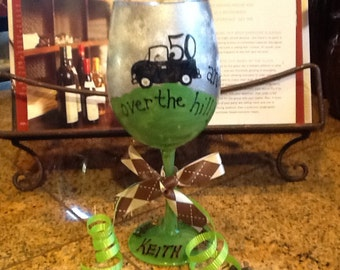 """Custom order sample  """"50 and Over the hill"""" Happy 50th Birthday Keith 12oz wine glass"""
