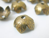 10 pcs Leaf or Flower Bead Cap  9x4mm Vintage Brass Finish Fits 8 - 10 mm Bead FN008-VB