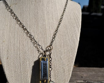 wire wrapped stone necklace with mini harmonica pendant
