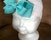 Light Tiffany Blue bow baby headband. Boutique Bow on a super soft lace headband fits newborn, baby, infant and toddler