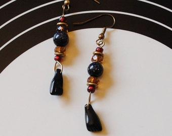 black fist earrings