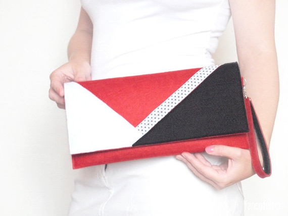 white and black geometric felt clutch bag