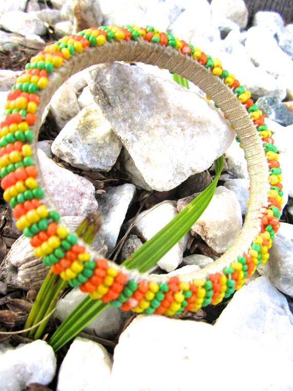 Handmade bracelet in yellow, green and orange beads / round bangles