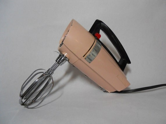 Vintage pink electric hand mixer