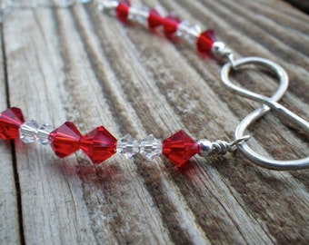 Sterling silver infinity anklet with red and clear Swarovski crystals