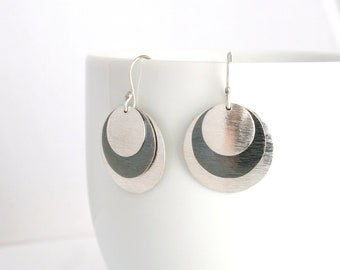 """Sterling silver triple disk earrings of three dramatically connected round shapes. """"Captivating Earrings"""""""