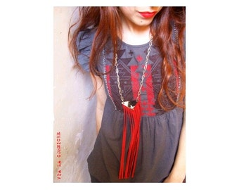 Red fringes and metal star necklace