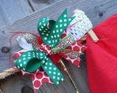 Christmas Infant headband with red and green ribbon and red feathers Christmas bow