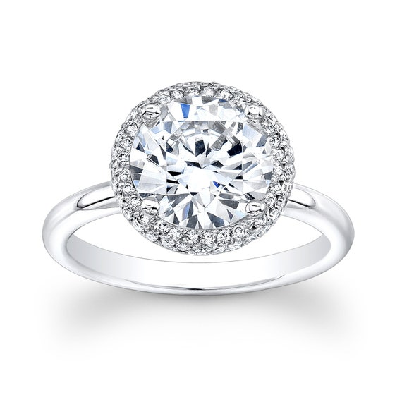 Ladies 18kt white gold diamond halo engagement ring with 2.00 ct round white sapphire and 0.30 ctw G-VS2 quality diamonds