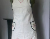 lovely pinny apron made from a vintage kit. hand embroidered and finished with tape.