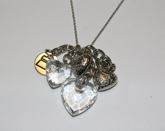 18 in Necklace with large silver heart charms, purse charm and clear charms.