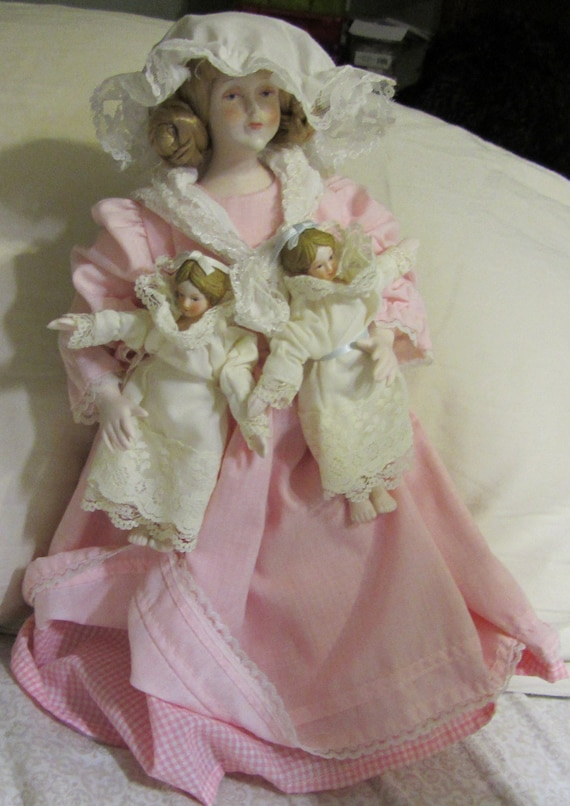 Vintage Francesca 1988 The Doll House Doll with Twins In Her Arms Porcelain Tree together