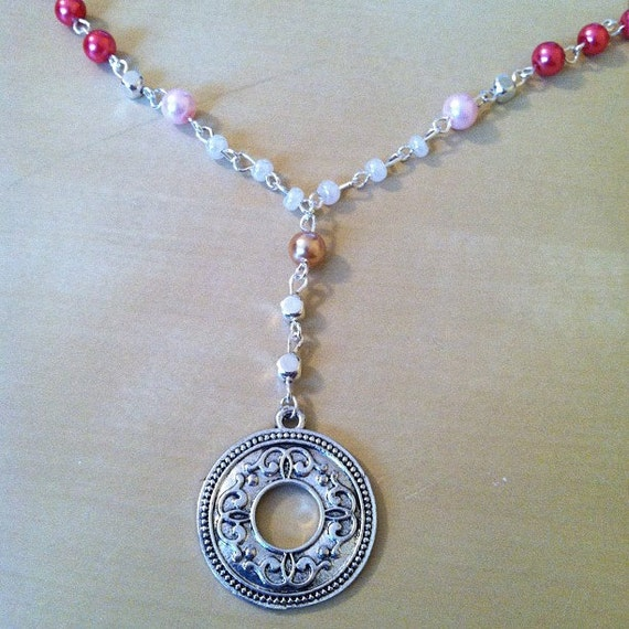 Hand-made pink, silver and tan beaded necklace with circle pendant
