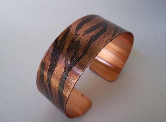 Copper cuff bracelet created from sheet metal and etched in a stunning zebra pattern