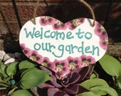 Welcome to our garden - decorative wooden heart