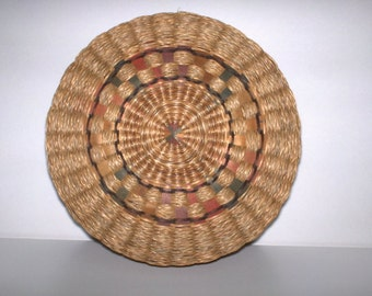 Sweet Grass Indian Sewing Basket still has the sweet grass fragrance. Interwoven dyed wood splines add decorative designs.