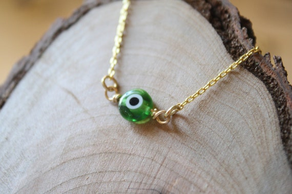 Evil Eye Protector Bracelet in Green and Gold, Brass